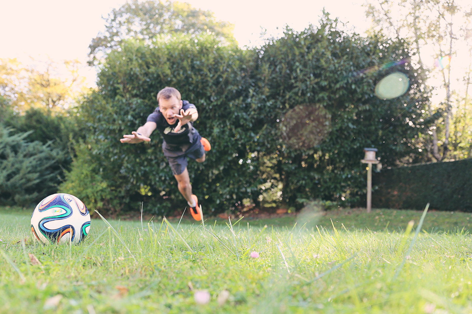 An attempt at a cool soccer stock photo. We mis-timed the ball drop, and it fell too soon.