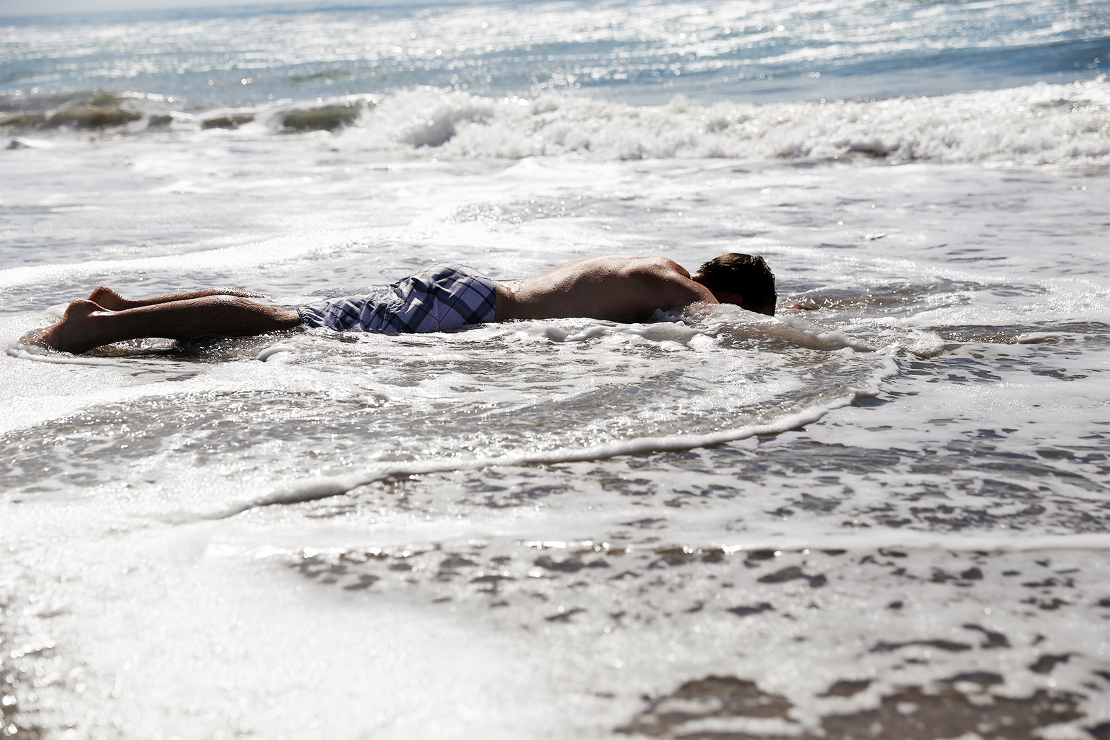 """I thought it would make a cool stock photo to try, """"body in waves."""" I don't think it worked and I got a lot of sand in my ears."""