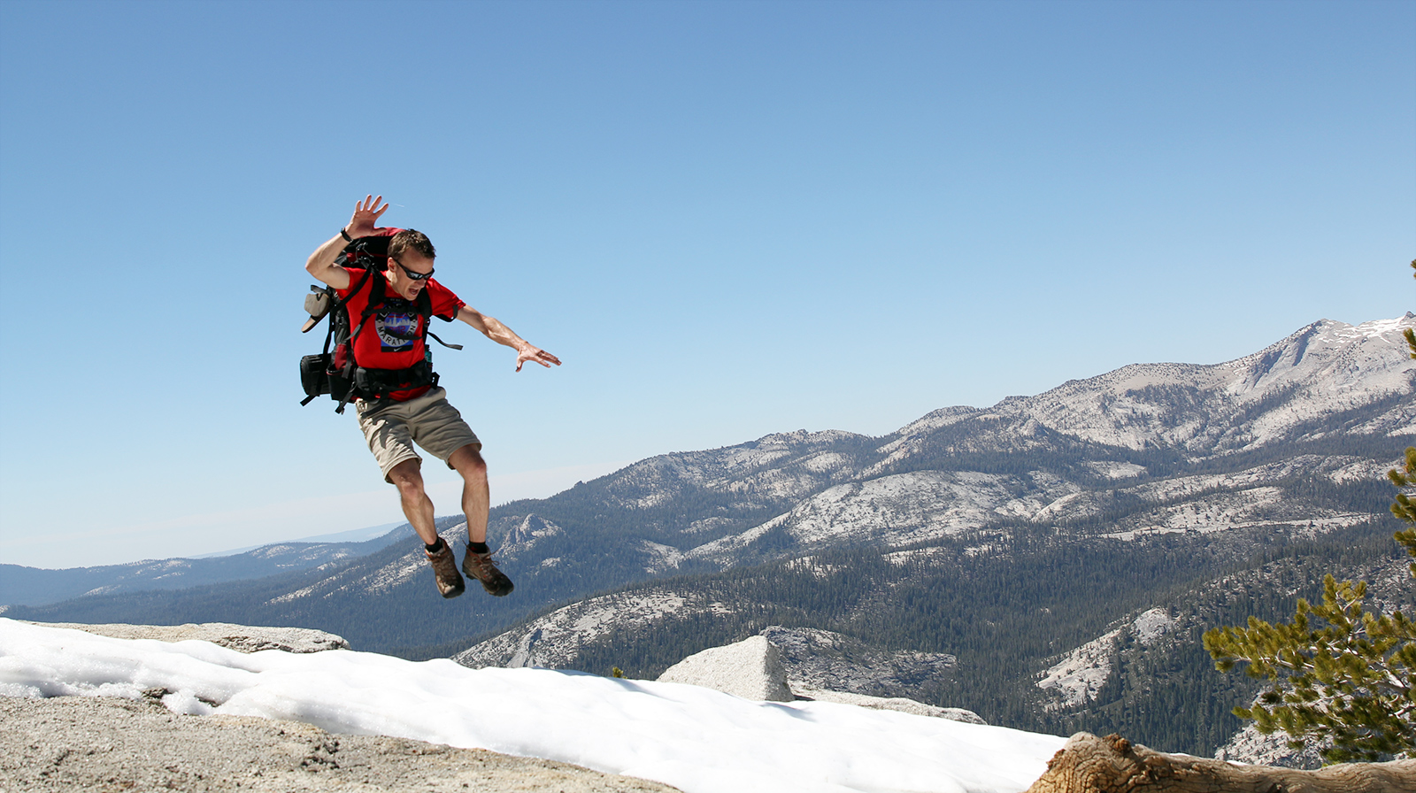 """Trying to get a cool """"hiker in mountain"""" pose. I did NOT land the jump (jumping with backpack into snow is not advised)."""